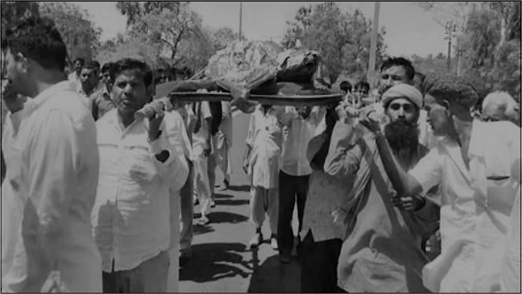 Sadhus in Barmer take out funeral procession of cows.